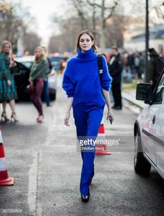 Laura Love wearing blue knit is seen outside Valentino during Paris Fashion Week Womenswear Fall/Winter 2018/2019 on March 4 2018 in Paris France