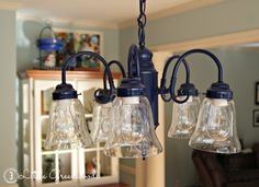 Navy Kitchen Chandelier by 3 Little Greenwoods: Who says chandeliers have to be a metallic color? Make them the colorful centerpiece of the room! Spray paint it with one of the many colors available using Rust-Oleum Ultra Cover 2x.