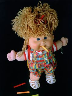 """Parent went ape trying to score one (or more!) of the Cabbage Patch Kids for their offspring.  Each doll had an adoption certificate for completion by the adoptive """"parent"""" and unique hair styles and attire."""