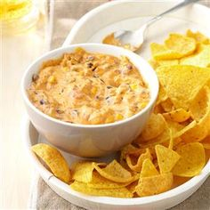 25 Favorite Dip Recipes for a Crowd - From taco dip to spinach dip, these potluck dip recipes are ready to party. Find 25 crowd-pleasing dip recipes perfect for game day or potluck gatherings. Tell guests to dig in—each recipe serves 12 or more!