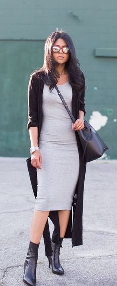 Walk in Wonderland in a body hugging gray dress and long cardigan.