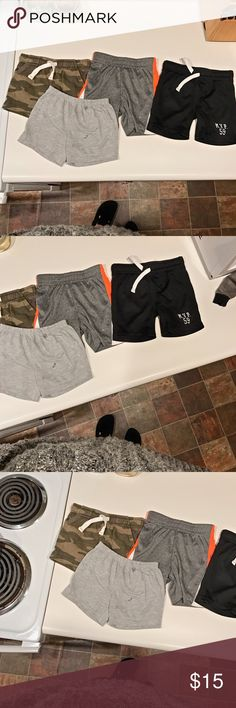 Boy Shorts Bundle Shorts bundle. That isn't actually a stain on the grey shorts... my son decided to throw his soppy cup on the clothes before I took the pic 🤷🏻♀️ my apologies!! Bottoms Shorts