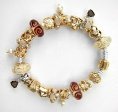 Gold Pandora Bracelet with white and brown accents