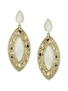 Adorned with a warm ivory neutral in a classic shape,@KimKardashian 's Belle Noel Nugget and Ivory earrings will make a beautiful addition to your jewelry box.  #KimKardashian #BelleNoel