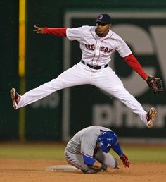 Boston Red Sox shortstop Xander Bogaerts, top, leaps over Texas Rangers left fielder Shin-Soo Choo as he turns a double play during the eigh...