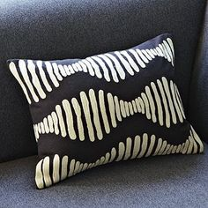 I love the Embroidered Hourglass Pillow Cover on westelm.com
