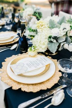 Starburst charger makes a statement against the navy blue tablecloth  Style Me Pretty