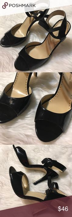 Black heels size 9 Adrienne Vittadini black heels. 4 inch heel.  Black patent and elastic band that goes across the top of your foot. Size 9. Adrienne Vittadini Shoes Heels