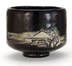 Black Raku tea bowl with design of mountain retreat by Ogata Ihachi (Kyoto Kenzan II, act. ca. 1720–1760) Japan, Edo period, mid-18th century Clay; black lead glaze; white slip, iron and cobalt pigments under transparent lead glaze Gift of Charles Lang Freer F1902.53