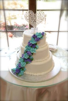 Simple, elegant wedding cake, blue and purple flowers, butter cream frosting, marble cake.