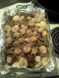 Easiest meal ever: 1 can green beans, 1 can potatoes, rinsed well, and 1 lb smoked sausage. Spread all ingredients evenly. distribute 1/4 cup butter over ingredients. And add seasonings! Bake covered at 350 for 30 mins . Remove foil and broil on low for 15 mins or until golden brown.
