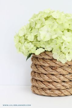 DIY Nautical Rope Vase via www.julieblanner.com - Floral arrangements with white & blue hydrangea; other red flowers to be in separate containers. (Should be inexpensive to create)