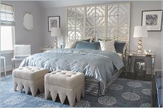 Mabley Handler used plenty of texture and sparkle to wow in this bedroom.  Note the layers of mirrors instead of a conventional headboard.