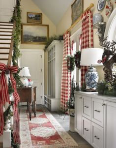 Love this narrow entry with stairway, dresser and windows.  Also love the placement of artwork and plates.  Atlanta Christmas House James Farmer and Maggie Griffin