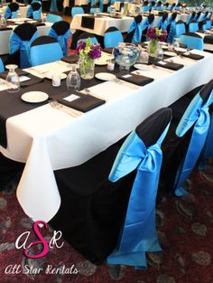 Nautical inspired wedding reception using black chair covers and a lighter blue sash!