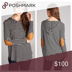 "Striped Elbow Patch Hoodie Black and Ivory Striped Long Sleeve Hoodie. Cute Suede Elbow Patches. Attached Hoodie with Drawstrings. Lightweight Comfortable Jersey Material. Perfect for the start of Fall! 96%Rayon 4%Spandex  ✨Use the ""Buy Now"" or ""Add to Bundle"" Button to select your size for Purchasing✨ Tops Sweatshirts & Hoodies"