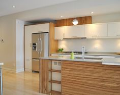 Fridge In Its Own Cabinet; Top Accent Chunk Of Wood Above Uppers