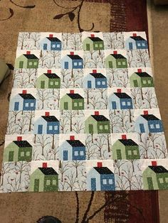 Great idea. Trees between houses. Hope I can find this fabric.