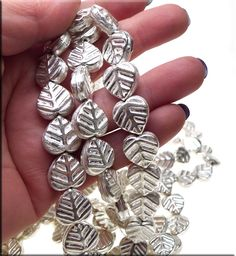 Leaf Beads, Sterling Silver Plated, 15x14mm (2) - Sterling Silver Plated Copper Leaf Beads. These Leaf Beads measure approximately 15mm long x 14mm wide and 5.5mm deep and have ~1.75mm holes. As these were hand-crafted, slight variations may occur. Sold by Pair - 2pc -- these metal Leaf Beads are also available by Wholesale Bulk Strand (please see listing F2155).