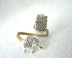 Silver owl ring with an elephant. $19.00, via Etsy ... Holy Shit! It's Sissy & Sissy in animal form, on a ring. IJD.
