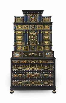 A SOUTH GERMAN ORMOLU-MOUNTED EBONY, EBONIZED AND PIETRA DURE CABINET ON CHEST PROBABLY AUGSBURG, THIRD QUARTER 17TH CENTURY, THE CHEST LATE 18TH/EARLY 19TH CENTURY, REUSING 17TH CENTURY PIETRA DURA AND PIETRA PAESINA PLAQUES, THE UPPER SECTION WITH SOME FURTHER ASSOCIATED ELEMENTS 89 in. (226 cm.) high, 28 in. (71.12) wide, 26 in. (66 cm.) deep