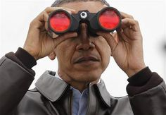 President Barack Obama looks through binoculars to see North Korea from Observation Post Ouellette in the Demilitarized Zone, the tense military border between the two Koreas, in Panmunjom, South Korea, Sunday, March 25, 2012. (AP Photo/Pablo Martinez Monsivais)