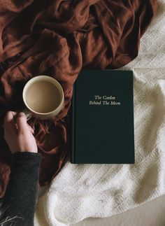 cozy blanket, a book, and a cup of coffee
