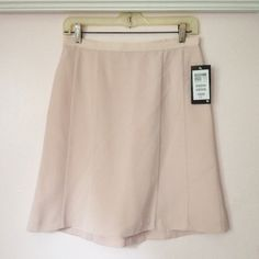 """SALE NWT H&M Pastel Pink Skirt (Sz 6)  Brand new, never worn! Silky smooth fabric, flowy with a slight flare at the bottom. High-waisted. Interior lining. Rear zipper & button closure. Hanger straps for convenient storing. 100% Polyester. Comes from a clean, smoke-free home.   --------✄--------MEASUREMENTS--------✄-------- (taken on flat surface - use for accurate sizing) WAIST: 14"""" across 