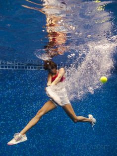 Woman Playing Tennis Underwater. Fotoprint van Christian Vizl bij AllPosters.nl