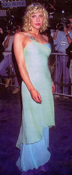 When Courtney Love was a movie star she rocked it. Beautiful one shoulder blue and green chiffon dress.