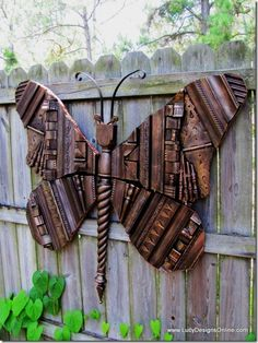 giant molded butterfly using everyday discarded items....wow...love it!