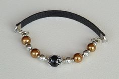 Check out this item in my Etsy shop https://www.etsy.com/listing/289742817/bracelet-black-and-gold-glass-pearls