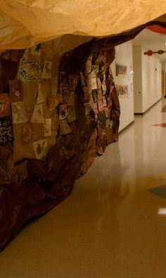 """Create """"cave"""" in library or in hallway to office? Stone Age: grade cave paintings displayed in hallway cave"""