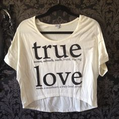 Ivory Rhinestone True Love Definition Crop Top Cream off white ivory high low crop top with black sparkly rhinestone sequin letters with a dictionary like definition of true love. Very sweet, cute, and girly. Soft material. Only missing a few stones. Loose flowy fit. Could fit a S or a small medium as well. (Shorter/tighter fit of course) perfect valentine's day shirt Charlotte Russe Tops Crop Tops