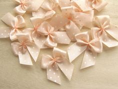 One of my favorite Etsy shops- squishnchips- sells these cute tiny little peach polka dot bows. Perfect for cupcake toppers!