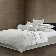 The luxuriously indulgent Madame Ning collection by Natori uses fine silk and cotton to create this beautiful coverlet. It features intricate detailed layered embroidery that adds texture to the face. The reverse is made with 300tc cotton sateen for a slight sheen and soft feel for the comfort you deserve. The metallic silver color and cotton filling used in this coverlet gives a rich look and feel that matches with all other pieces in the collection.