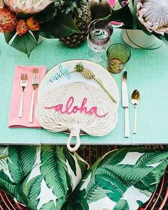 Happy Tuesday! We're shaking things up today with this super colorful and tropical #tablescape #weddinginspo. I wouldn't mind sitting at a table designed like this! Photo: @meganwelker, planning & design: @beijosevents, florals: @mvflorals. Originally found on @100_layercake! Rentals: @borrowedblu, laser-cutting: @pitbullsposies