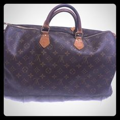 "Louis Vuitton Speedy 35 Speedy 35. Used. Plenty of life left. No dust bag, no receipt, etc.  just the bag. Pics are part of description. Will add additional pics in separate listing.  trade value 360. If you're interested in knowing my ""lowest,"" please just use the offer button. Thanks!! Louis Vuitton Bags"