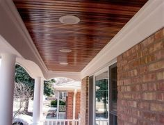 Stained tongue and groove porch ceiling.