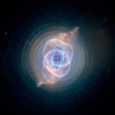 Cat's Eye Nebula. Photo by NASA, ESA, HEIC, and THE HUBBLE HERITAGE TEAM (STSCI/AURA), Acknowledgment R. Corradi (Isaac Newton Group of Telescopes, Spain) Z. Tsvetanov (NASA).