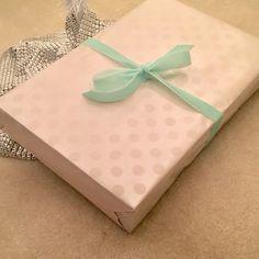 Polka dot gift wrap looks lovely under a white tree