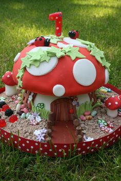 toadstool cake by Littlebuttontales, via Flickr--  pretty elaborate.  Maybe just do a round cake like the top portion.