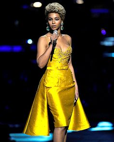 During the tribute to Etta James at Conde Nast Media Group's Fifth Annual Fashion Rocks in 2008, Beyonce dons a short blonde wig and a Zuhair Murad Spring 2008 Couture dress. The mustard works perfectly this time around, appearing both vintage yet elegant.