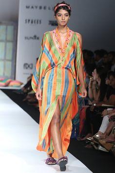 Orange striped draped maxi dress. #carma #carmaindia #fashiondaily #instadaily #instafollow #shinebright #printperfect #prints #indianfashion #ethnic #loveit #anupamadayal #cocktailsdresses #cocktailnight #diwali #diwaliparty #runwaytocarma #saree #festive #festivefashion #instastyle #design #boho #ootd #orangedress #maxidress #stripeddress