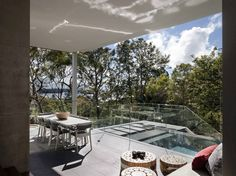 This project is a new house in Vaucluse on a steep heavily wooded site overlooking the harbour. The architectural idea was to create a series of solid horizontal planes extending into the landscape with these elements contrasted by a vertical infill of dark timber boarding or glazing. The overall effect is a clear distinction between the man made horizontal planes of the house with the vertical eucalypt tree trunks #MHNDU
