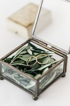 Top 6 Sage Green Weddings Color Palettes---Sage & Gold, creative and romantic way of placing ring in a box layered with foliage , elegant and fresh country wedding, forest wedding theme, spring ,fall/winter wedding ideas.
