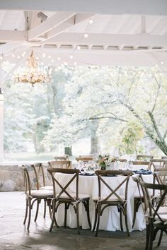 Covered slate floored pavilion finished with the prettiest chandelier and string lights #cedarwoodweddings Chic and Soft Farm Industrial :: Leslie+Jason | Cedarwood Weddings