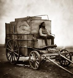 Year 1855 :: Pioneering British photographer Roger Fenton's photographic van ::  ( his assistant in the picture, Crimea)