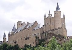 Alcazar de Segovia  Segovia, Spain  The Alcázar, or castle-palace perched at the tip of the promontory  towers over the countryside below. Like many fortifications in Spain, it started off as an Arab fort. During the Middle Ages, the Alcazar of Segovia  the favorite residence of kings of Castile, and almost each king added new parts to the building,