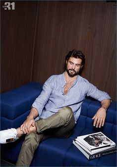 Walter Savage lounges in a striped linen shirt and chinos by LE 31.